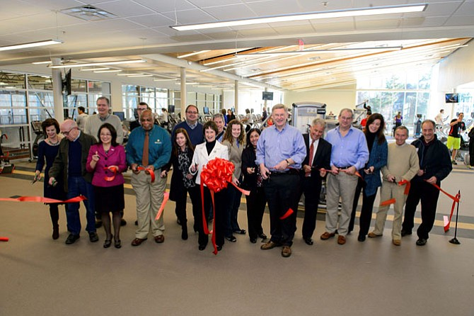 Fairfax County Board of Supervisors Chairman Sharon Bulova and Dranesville Supervisor John Foust - center - join representatives from the county Park Authority, McLean Youth Athletics and staff at Spring Hill Recreation Center's ribbon cutting Jan. 10.