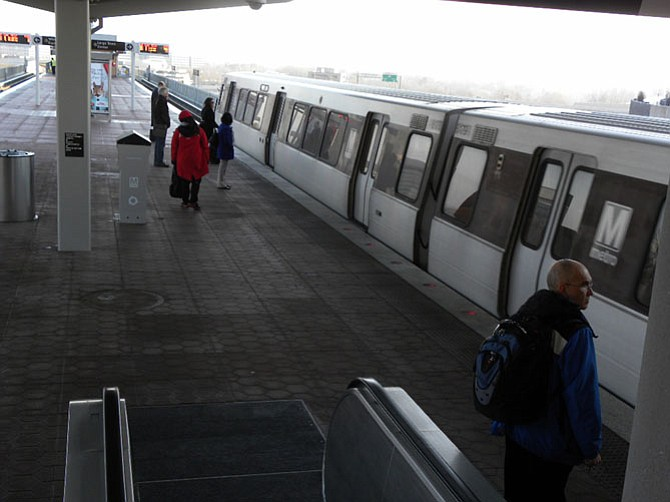 Riders at the Tysons Corner station get ready to board the Silver Line train to Largo Town Center.
