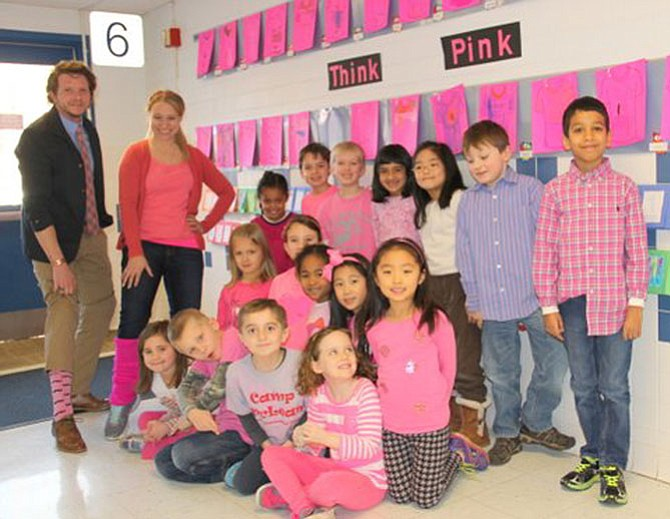 Mary-Lynn Robosky's first graders supported anti-bullying efforts by wearing pink and creating a wall of pink t-shirts with their own anti-bullying slogans. Pictured, from left, top row: Student Teacher John Patterson, first grade teacher Ms. Robosky, Hannah Workie, Nico Williamson, Logan Schwartz, Julie Seth, Tara Chun, Max Brooke, Victor Chopra; middle row: Cara Dinker, Gabriela Cid, Nadira Maples, Paris Diao, Katie Lee; and bottom row: Morgan Heuber, Spencer Buddie, Aidan Khazai, Haley Lucier.