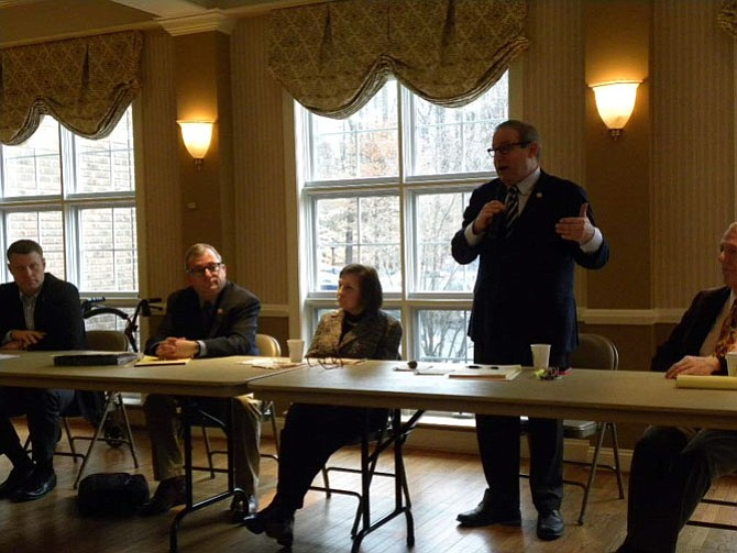 From left, Supervisor Jeffrey McKay, state senators Adam P. Ebbin and Linda T. Puller, Del. Mark D. Sickles, and state senator George Barker hold a town hall meeting at Thompson Center in Alexandria on Saturday, Jan. 24.