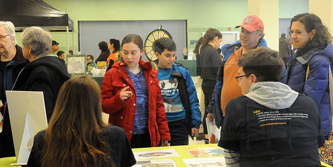 Residents of all ages took advantage of the information gleaned from the volunteers and experts at the Energy Journey Game last Saturday afternoon at Wakefield High School.