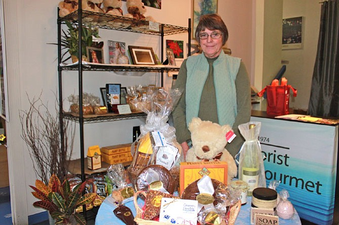 Linda Fuller, owner of Lake Anne Florist, showing off her wares in December.