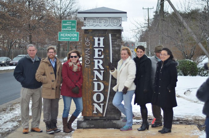 Town of Herndon Mayor Lisa Merkel and members of the Town Council, Planning Commission and staff gather on Jan. 27 to unveil one of the new gateway signs. Seven signs have been erected at the town's entrances designed to welcome residents and visitors.