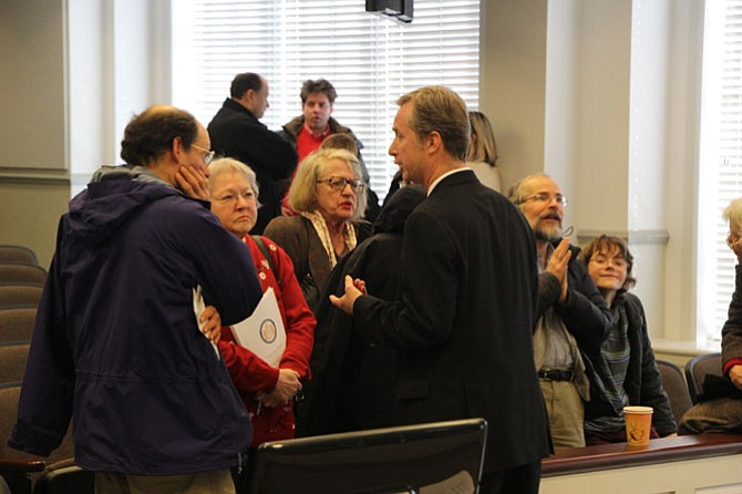 Del. David Bulova (D-37, center right) meets with constituents following the town hall meeting Jan. 31.