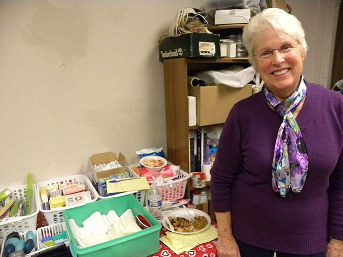 Volunteer Gail Michael minds the hygiene supplies made available to clients of Facets of Fairfax's hypothermia program. Toothbrushes, shaving materials, and other hygiene products are available for clients to take.