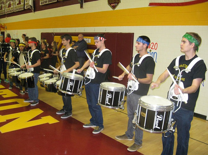 The Oakton High School Drumline revs up the crowd.