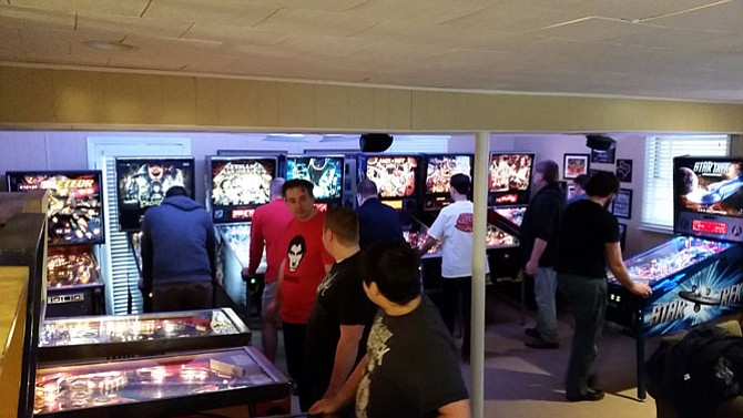 """Kevin Stone, """"Pinball Kevin,"""" hosted this year's Virginia State pinball championship in his home in McLean. Virginia was one of 33 states that held a simultaneous tournament on Saturday, Feb. 7."""