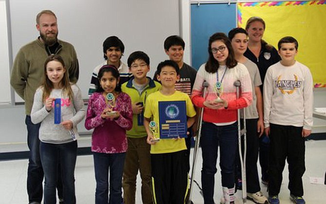 Pictured from left are: Bee co-sponsor Scott Gustaveson, Sophia Stagarescu, second place finisher Riya Dev, Siddhant Ranka, Joshua Kim, winner Joshua Lian, Will Hendricks, third place finisher Katie Williams, Max Ellis, co-sponsor Meghan Roman and Dillon Proxmire.