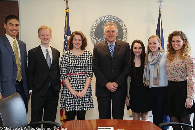 From left: West Potomac High School junior Taamson Joshua, WPHS senior Kelly O'Meara, Mount Vernon High School Senior Catherine Ming, WPHS junior Emma Kelly, WPHS senior Margaret O'Meara and WPHS senior Jayne Orleans meet with Gov. Terry McAuliffe (center) at the Amundson Institute.
