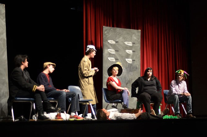 Herndon High School has long had active drama, music and arts programs. In February, students in the drama team put on two one act plays. In this scene, the Inspector (Raleigh Hampson) inquires about the murder of the mysterious host (Moritz Barth). Other cast included Allie Kassraie, Sarah Inge, Jordan Rees, Hannah Carrithers, and Justin Spiegel.