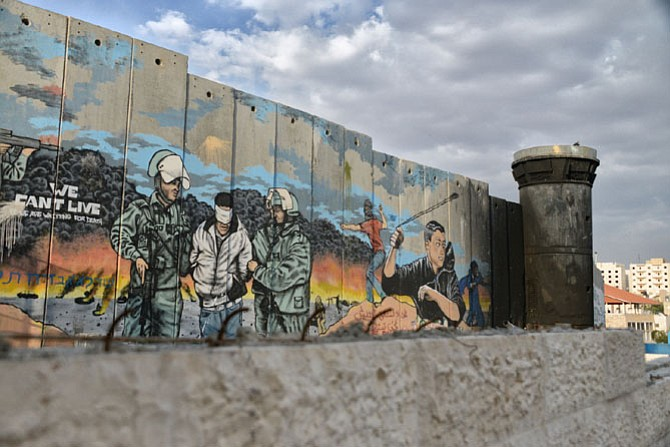 The Israeli Separation Wall with guard tower borders the Aida Refugee Camp in the northern part of Bethlehem (photo April 2013). A six-week film and discussion series at Grace Presbyterian Church in Springfield explores three generations without peace in the Holy Land.