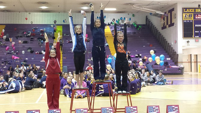 Washington-Lee senior Sophie Hatcher, second from right, won the 6A North region all-around title and Yorktown freshman Bella Kane, second from left, finished runner-up on Feb. 11.