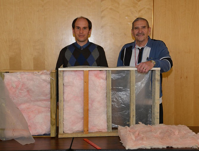Architect Peter Henry and seminar host and presenter Rich Taschler showed the differences between standard wall construction and the super-insulated double wall/staggered stud method of framing that conserves a homes energy using a few handy props.