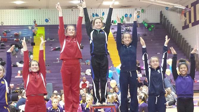 Fairfax gymnast Rachel Barborek, center, won the 6A North region floor championship on Feb. 11.