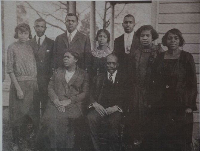 (Front row from left) Carrie Cartrell Gray and Hamilton Gray, (back row from left) Estelle, Ira, Isaiah, Ada, John, Florence and Cassie Gray. Hamilton is Gloria Wiseman's grandfather, who purchased nearly 10 acres of land in Gum Springs in 1894.