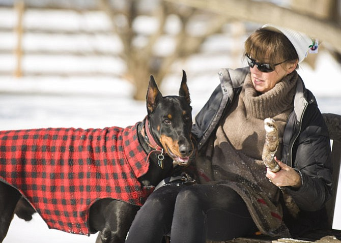 Angela Boyer and her Doberman Marz in a snow day last week in Great Falls.