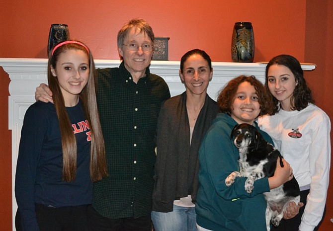 The Schneider family of McLean - Farah, Phillip, Fatima, Peter, and Sami - with their King Spaniel/Beagle mix, Tibby.