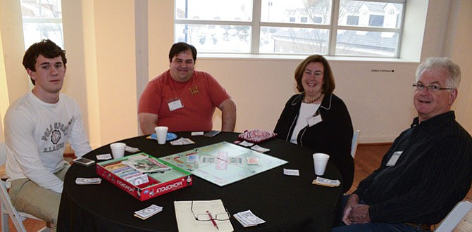 Paul Poling of Fairfax Station,  last years Monopoly Champion, getting ready to start against John Marani of Centerville, Kathryn Poling of Fairfax Station and Tom Moore of Fairfax Station.
