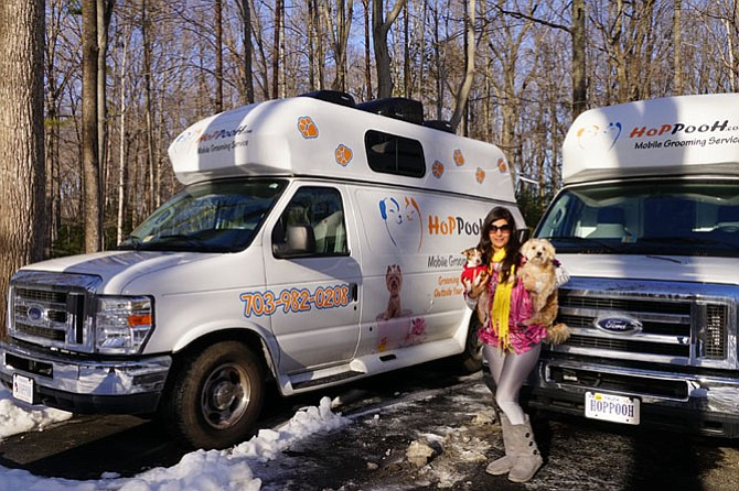Marzi Sharifi of HoPPooH in Fairfax with her dogs and her mobile pet grooming vans. Sharifi recently acquired a second van for her growing business.