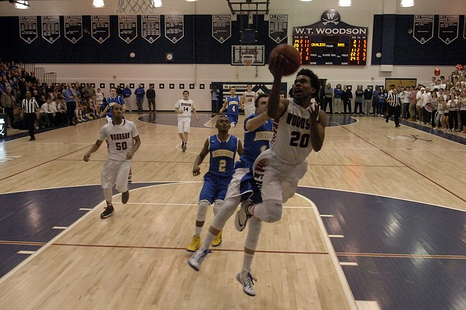 Eric Bowles, the Conference 7 Player of the Year, led Woodson with 27 points during the Cavaliers' 70-55 win over Robinson on Friday night in the opening round of the 6A North region tournament at W.T. Woodson High School.