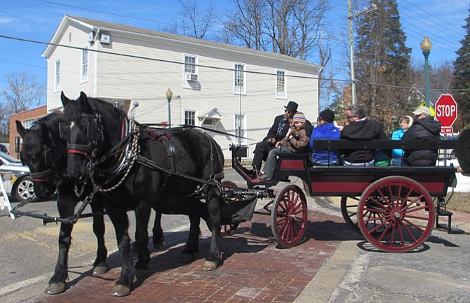 A horse-and-carriage took birthday guests along Mill Street.