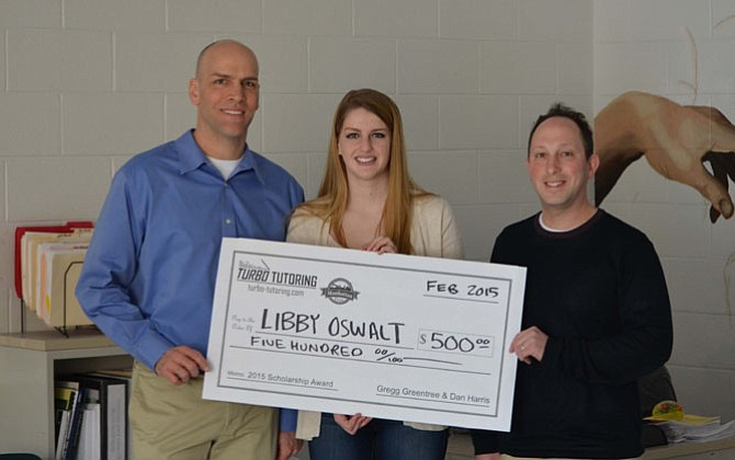Libby Oswalt (center), a senior at Chantilly High School, recently won $500 toward her college education.