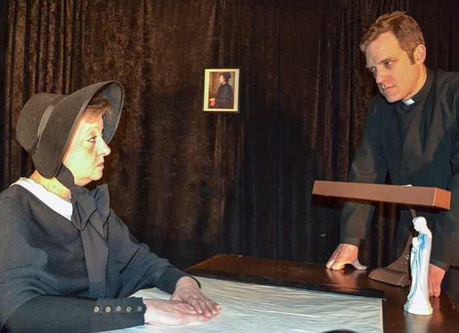 A tense moment between Lisa Bailey (as Sister Aloysius) and Chris Andersen (as Father Flynn).