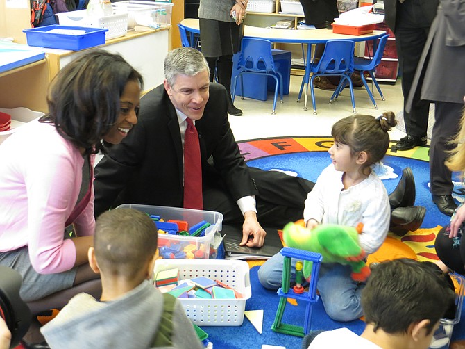 Patrick Henry Principal Ingrid Bynum (left) and Secretary of Education Arne Duncan (middle) observe pre-k students at work