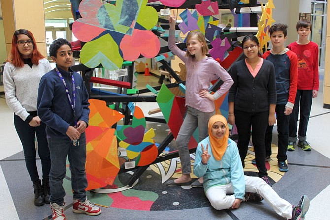 Evelyn Melendez-Quintanilla and Jiji Maghoub (left) with Maisum Qadri, Emma Wosje, Lena Smith, and Ryan Bloom (right) stand by their table designs. Jiji Maghoub's piece sold to the public.