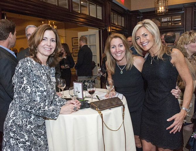 Amy Frix, Patti Hulett and Alison Duenkel at the Winter Wine Tasting at River Bend Country Club.