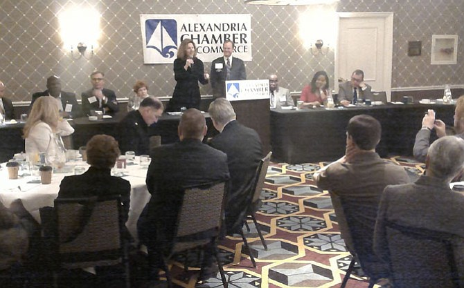 Vice mayor Allison Silberberg, standing center left, address attendees at the Chamber of Commerce Legislative Breakfast March 10 at the Hotel Monaco. Next to her is chamber government relations committee chairman Dak Hardwick.