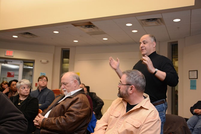 "Greg Paspatis of Alexandria (standing, right) speaks at the March 9 meeting of the Virginia Citizens Coalition for Police Accountability. Seated, from left, are Anita and Salvatore Culosi, parents of Dr Salvatore ""Sal"" Culosi, Jr, who was killed by a Fairfax County Police officer Jan. 24, 2006 outside his Fair Oaks townhouse."
