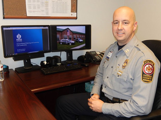 Capt. Bob Blakley at his desk in the Sully District Station.