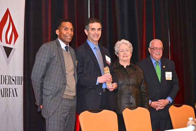 Honoring the winner of the 2015 Katherine K. Hanley Public Service Award, from left: Rodney Lusk, chair of the Award Selection Committee, U.S. Rep. Gerry Connolly (D-11), award recipient Dean Klein, director of the Fairfax County Office to Prevent and End Homelessness, and the award's namesake and a former recipient, Katherine K. Hanley.