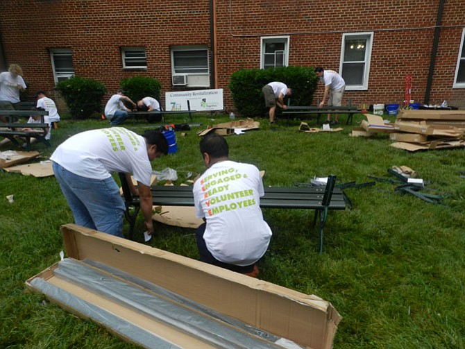 Volunteers build park benches.