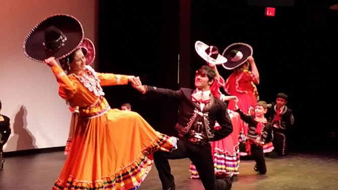 "Los Quetzales dancers showcase the traditional dance of the state of Jalisco, widely known worldwide as the ""Mexican hat dance."" The original name is ""jarabe tapatio,"" meaning melodies of the Jalisco people."