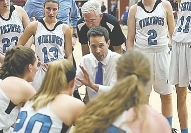Whitman girls' basketball coach Pete Kenah instructs the Vikings during their win over Wootton in the 4A West region championship game on March 9.