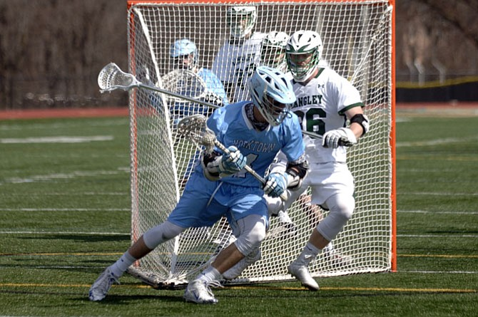 Senior attackman Charlie Tiene (4) is a captain for the Yorktown boys' lacrosse team.