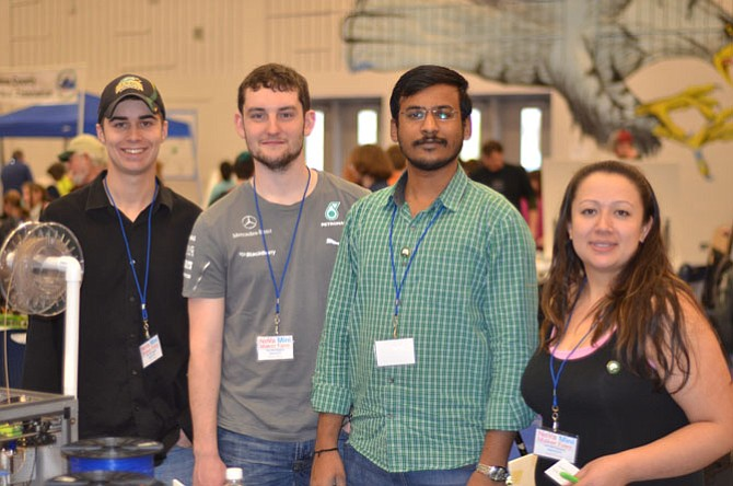 George Mason University students attended the March 15 annual Reston NoVa Mini Maker Faire and had booths at the South Lakes High School. Pictured are John Hill, Ryan Cerny, Nithin Ellanki, and Jade Garrett. Garrett is president of the GMU student operated Inventors Club.