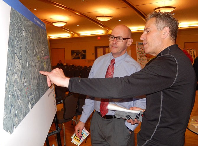 (From left) Transportation consultant Brian McMahon and resident Jeff Dove discuss the project.