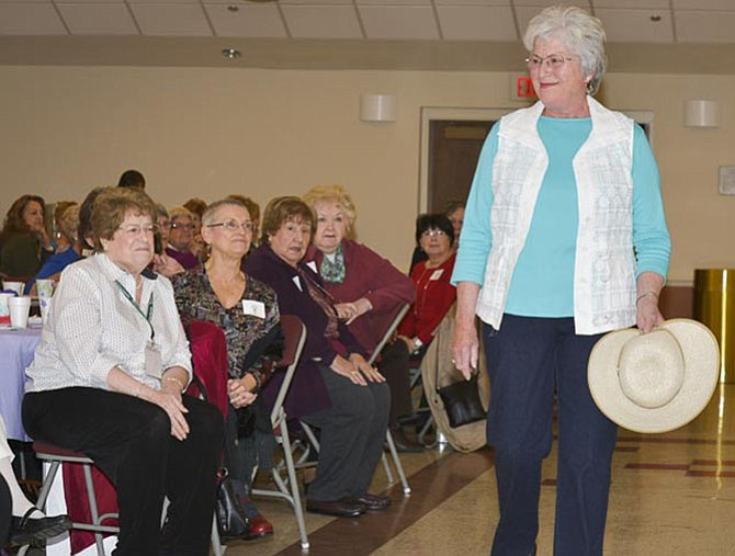 Mary Walher of Fairfax models a spring tunic and hat to the guests at Shepherd's Center.