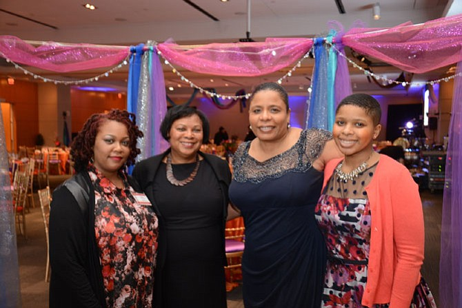 From left: Torria Baker, director of the UCM-Bryant Early Learning Center; Minnie McClure with the Early Learning Center; UCM executive director Nichelle Mitchem and UCM volunteer Danielle Adamson gather for the UCM Spring Gala, hosted by the Friends of UCM.