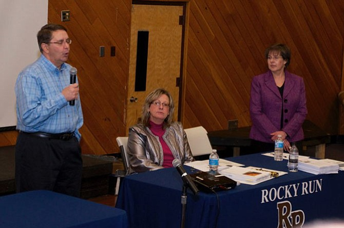 Sully Supervisor Michael Frey welcomes attendees to the annual Sully Budget Town hall meeting, to his right are Susan Datta, Director Fairfax County Department of Management and and School Board member Kathy Smith.