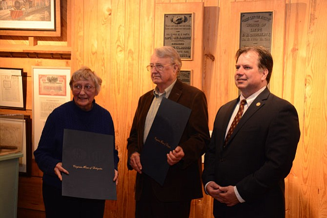 Del. Tim Hugo (R-40), right, recognizes former Friends of Fairfax Station president Joan Rogers and historian Lee Hubbard (center) at the Fairfax Station Railroad Museum.