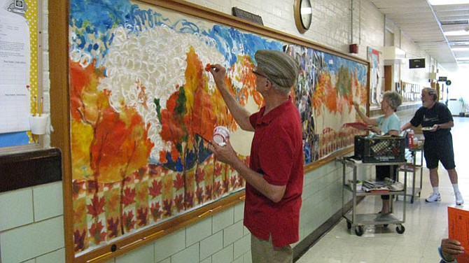 One of the county's Senior Center activities involves mural painting at a local school.