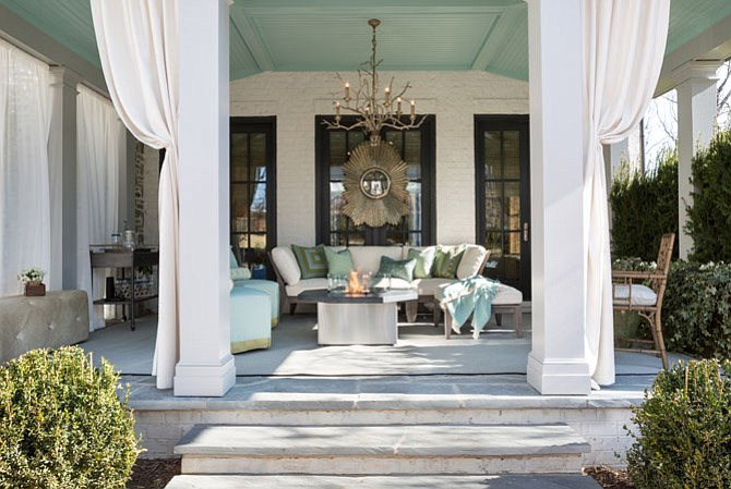 The home's loggia, designed by Nancy Colbert of Design Partners in McLean, offers views of the home's natural surroundings.