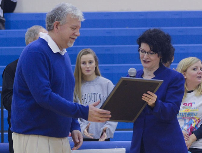 Marymount University President Matthew D. Shank receives a commendation from state Sen. Barbara Favola (Arlington) on behalf of the Commonwealth of Virginia for the school's 20 years of hosting the Annual Northern Virginia Special Olympics Basketball Invitational Tournament.