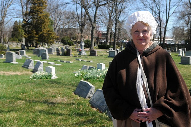 Stacy Hawkins as the Mistress of the Cemetery greets visitors to Ivy Hill on Saturday afternoon.