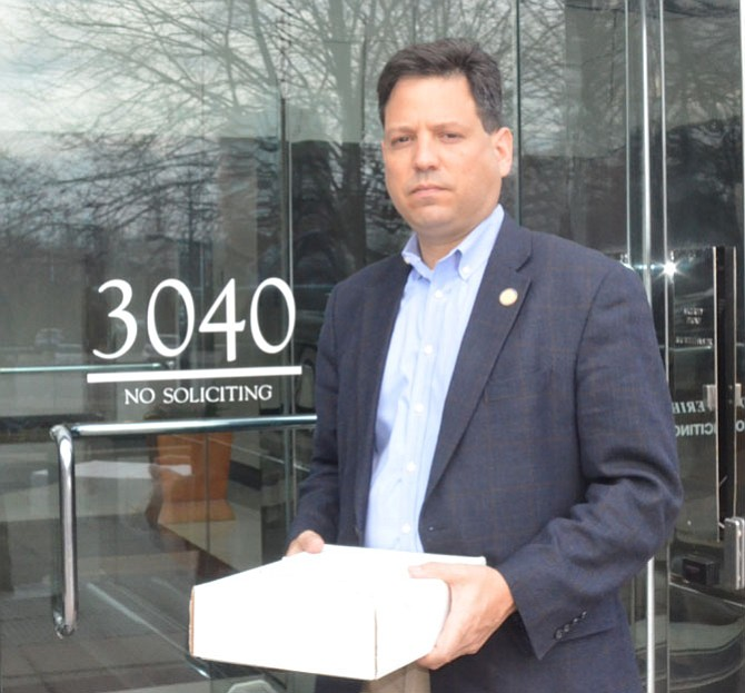 Del. Scott Surovell (D-44) delivers 500 signatures on a petition demanding widening Route 1 to the Northern Virginia Transit Authority.