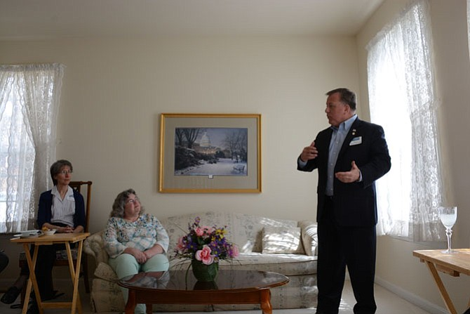 Beth Schaefer, a resident of the Franconia area of Alexandria, and Susan Valentine of the Kingstowne area of Alexandria, listen as Virginia Senate candidate and Dumfries Mayor Jerry Foreman outlined some of his campaign objectives. A meet and greet event took place in Valentine's home.